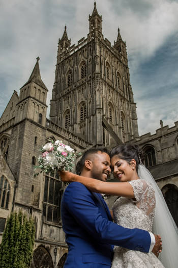 couple in front of a church after their wedding. Taken by Harvest Creative Media's asian wedding photography & videography service