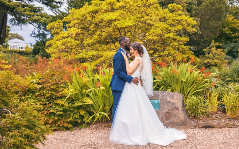 Interracial wedding ceremony by Harvest Creative Media