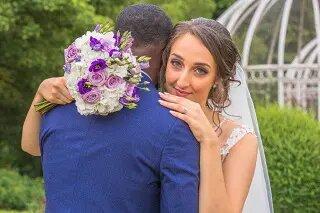 bride hugging husband at her asian wedding