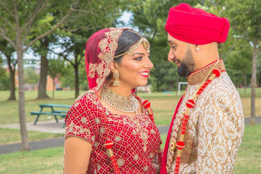 asian wedding photo with newly married couple
