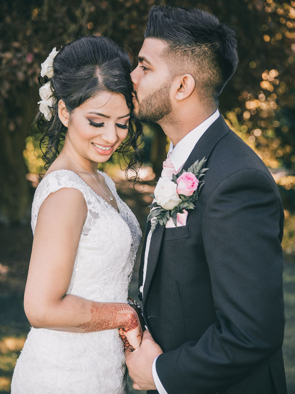 a couple at their wedding in west midlands