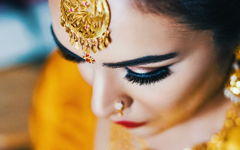 bride with close up photo at wedding in wolverhampton